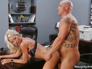 Light-haired secretary in stockings gives her tattooed boss a superior blowjob and fucks him after that