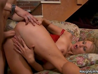Busty MILF in red clothes takes aside her panties and gets penetrated by dude