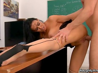 Brunette teacher with awesome boobs thinks that her student can bring her a lot of sexual pleasure