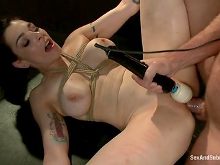 Fabulous dame with huge tits was tied up for BDSM punishment with vibrator