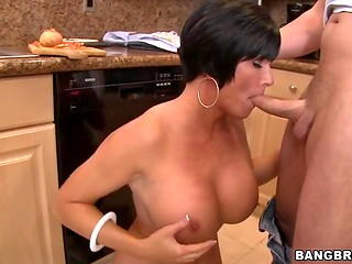 Instead of cooking brunette gives a lovely blowjob to a lucky guy right in the kitchen