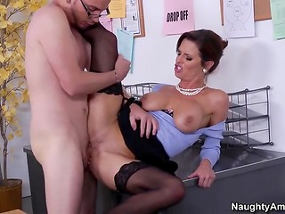 Fascinating cougar with big boobs seduces young colleague and fucks him in the office