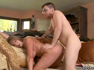 A youngster with glasses has to satisfy all sexual needs of an experienced busty MILF