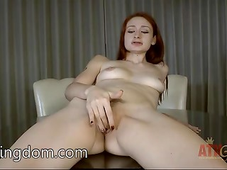 Redhead climbs on a small round table and demonstrated her delicious unshaved vagina