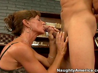 Wise woman in stockings was pleased with her dose of the oral sex action presented by a young guy