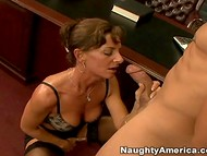 Wise woman in stockings was pleased with her dose of the oral sex action presented by a young guy  6