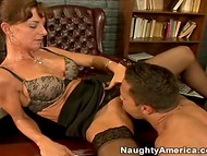 Wise woman in stockings was pleased with her dose of the oral sex action presented by a young guy  9
