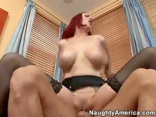 Unrepeatable red-haired MILF rides her partners cock like a wild bitch and presents awesome blowjob