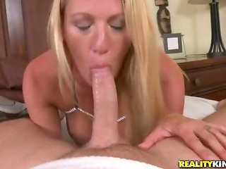 Charming blonde chick sucks wiener professionally and eats balls of a friendly dude