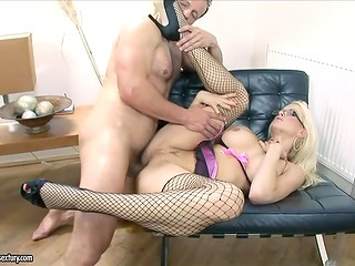 Fascinating lady in stockings gets her holes familiarly drilled by a huge-cocked gentleman