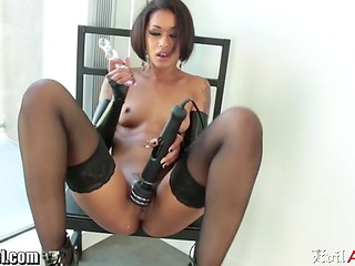 Always horny Ebony Skin Diamond tries to use the toys of all types being tied to a chair