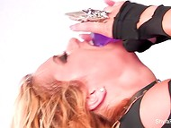 Starving cougar wildly jumps on a purple dildo imagining that it is a real boner  9