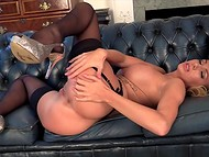 Pure perfection named Danielle Maye teases with her forms and masturbates on the sofa