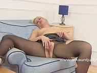 Perverted blonde lady masturbating her twat with a desire to reach the peak of pleasure