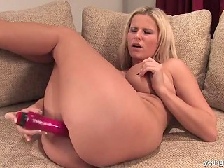 Busty blonde babe loves to sexually entertain herself using favorite red dildo